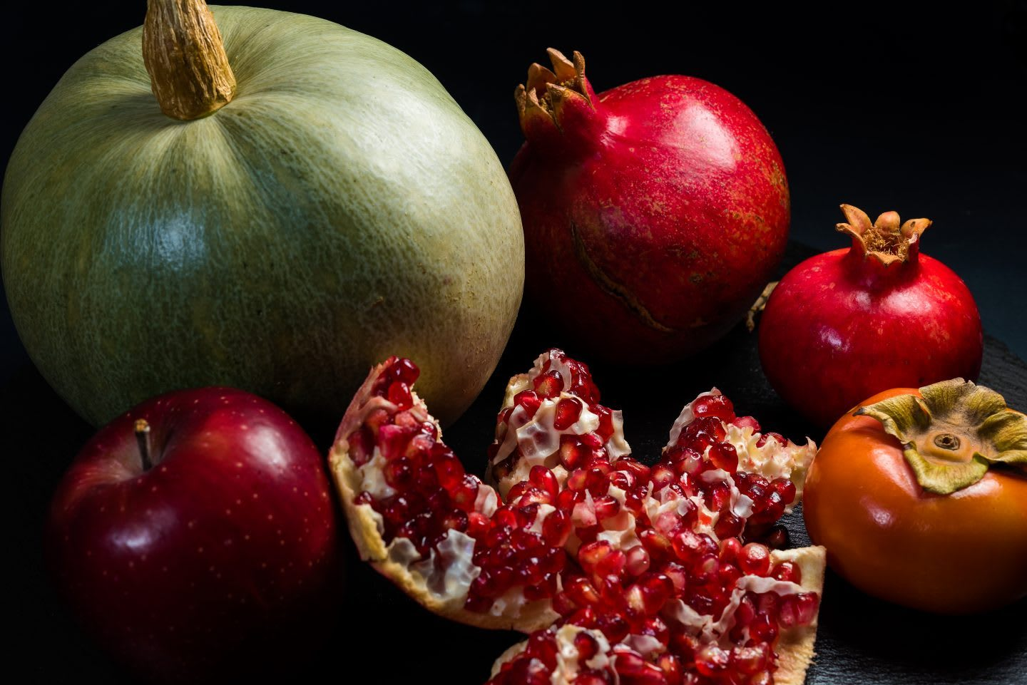 Fruits and vegetables arranged together in a group, pumpkin, apple, pomegranate, persimmon, fruits