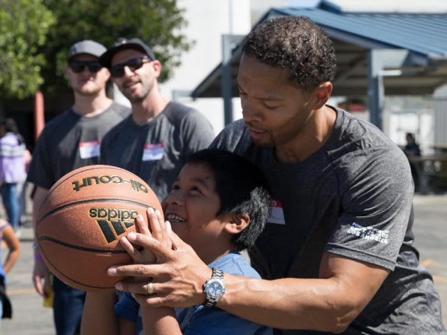 Man helping a child throw a basketball, sport, exercise, impact