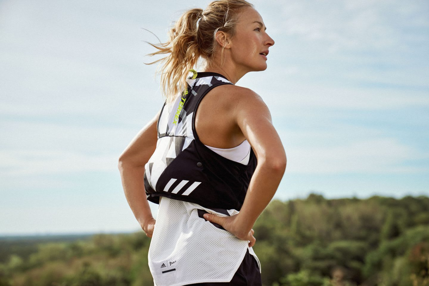 Woman looking out into distance at while trail running, adidas. sport. outdoors, running, apparel