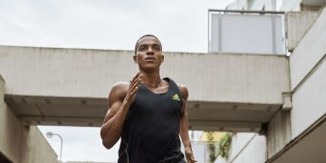 Man running through buildings, concentration, sport, focus, adidas, strong, running