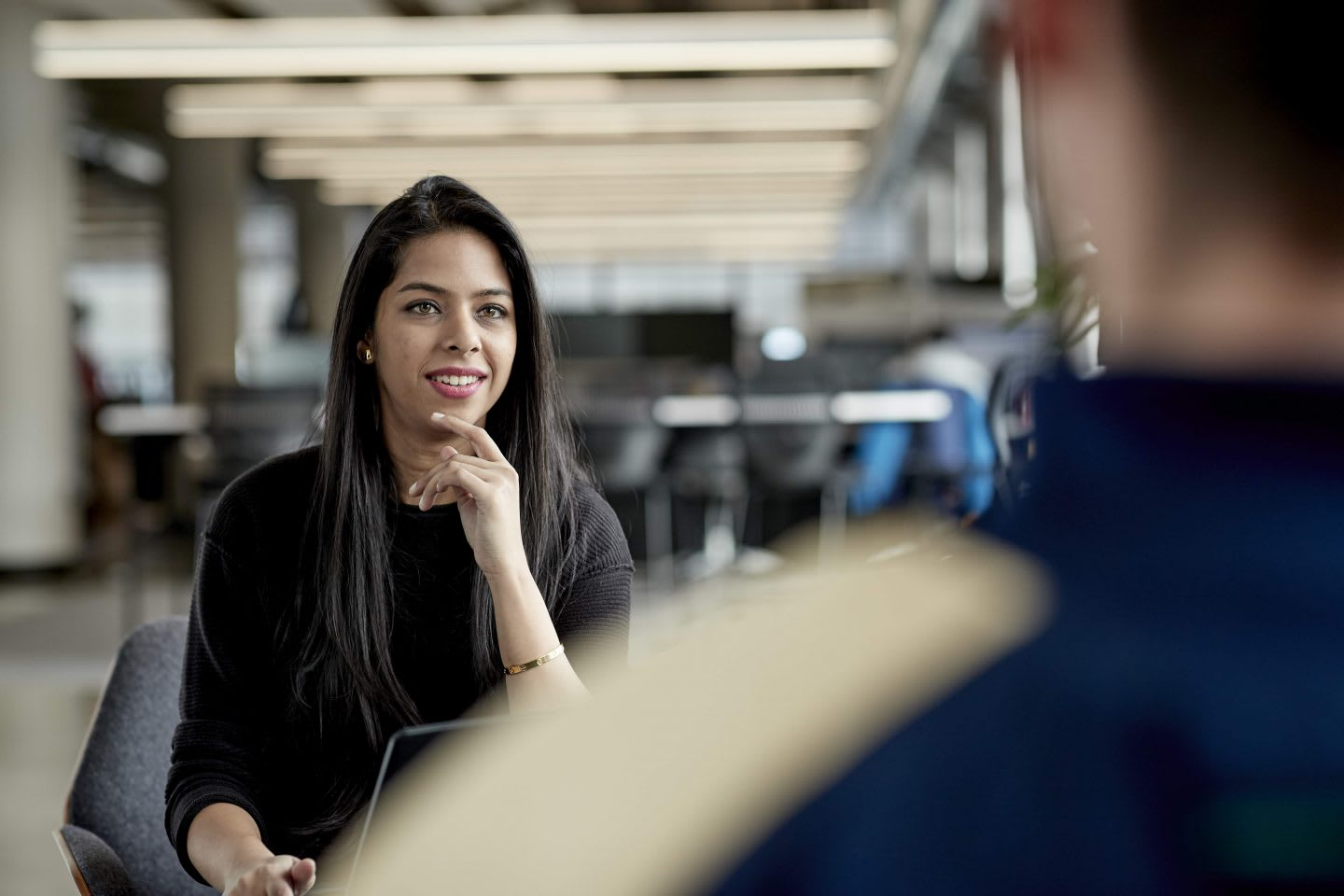 Woman having conversation with man at the office, team, mentoring, mentorship, career, job