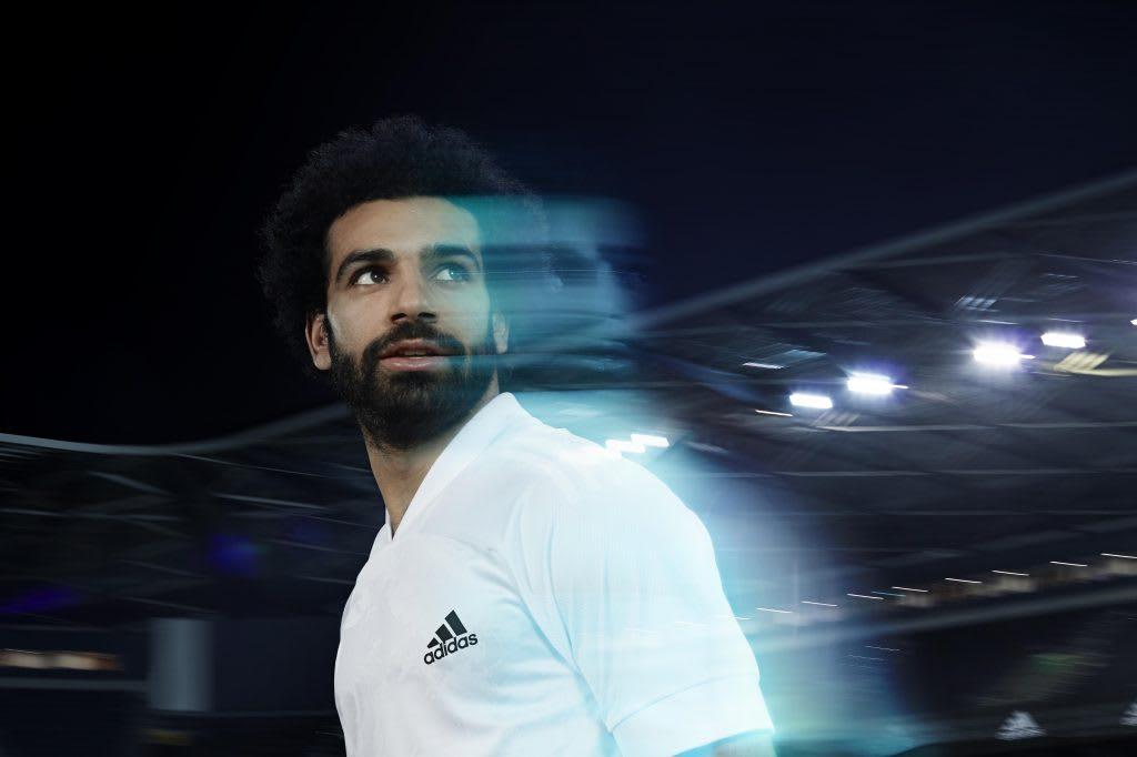 Man wearing white shirt looking behind him, Mo Salah, football, soccer, player, adidas, athlete, sport