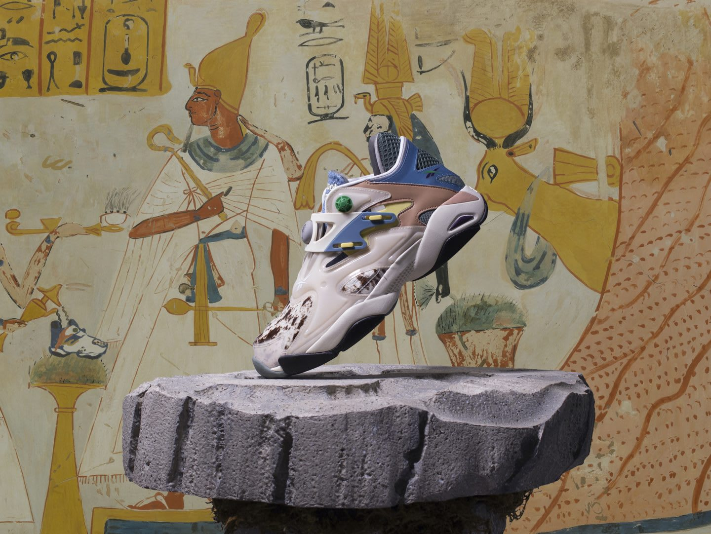 Reebok x Braindead sneakers on a stone in front of ancient mural, collaboration, teamwork, fashion, streetwear, partnership