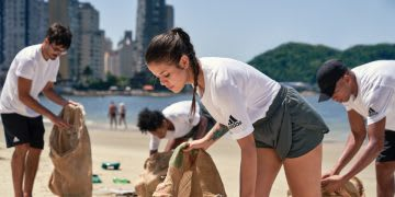 Men and women picking up plastic waste on the beach, adidas, Parley for the Oceans, sustainability, ocean, environment