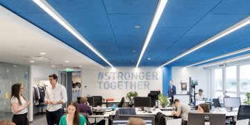 Men and working working in a co-working space in an office, Runtastic, Linz, Austria, HQ, headquarters