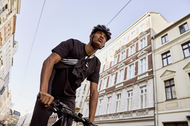 Man wearing bike helmet cycling in a metropolitan city, sports, bike, cycling, cycle, cyclists, adidas