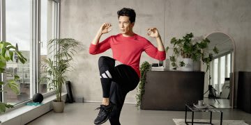 Man wearing red long sleeve t-shirt working out at home, adidas, training, man, sports, fitness