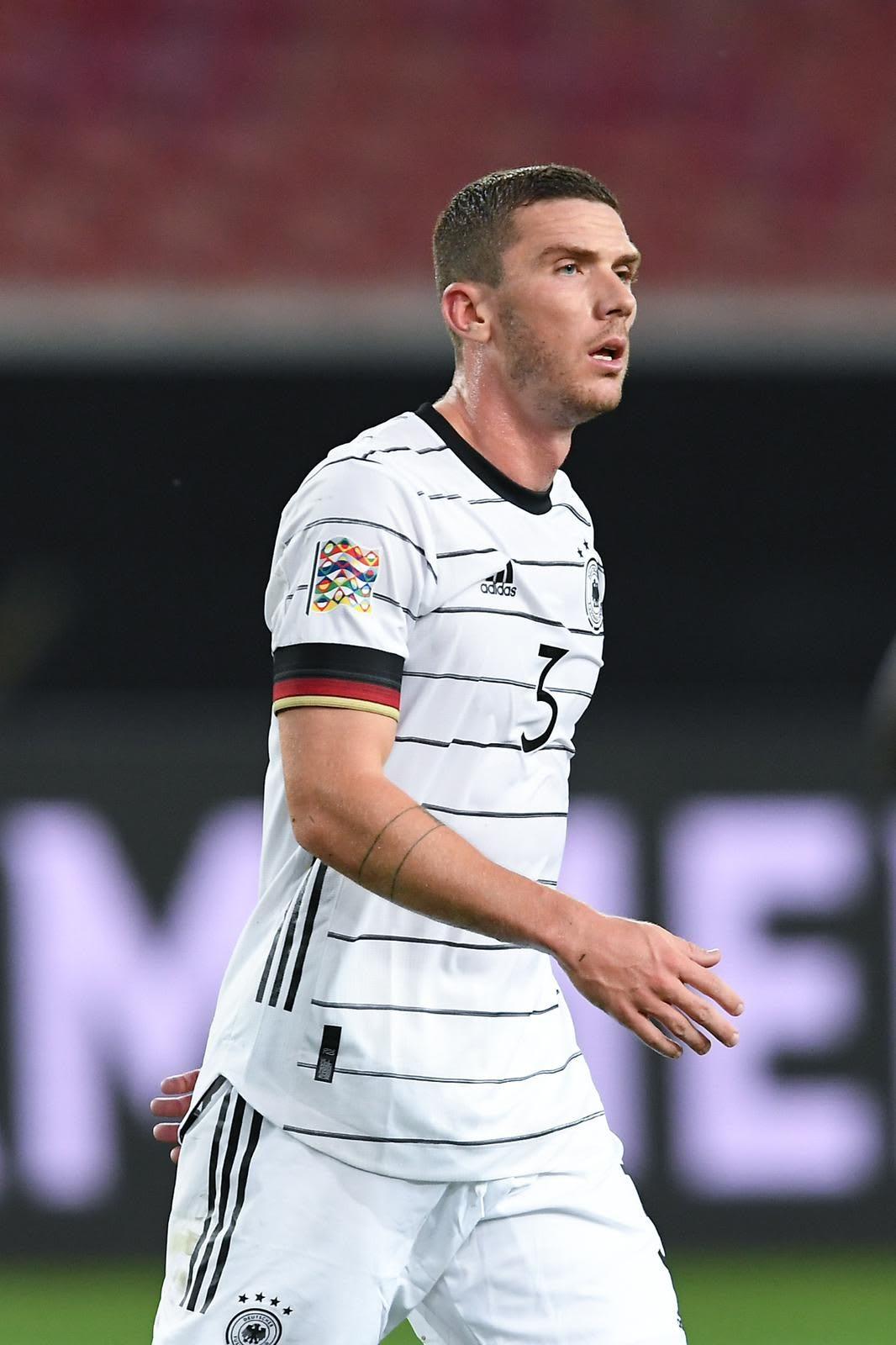 Caucasian man wearing white football jersey on a football pitch, Robin Gosens, footballer, football, German, Germany, team, adidas, sports, exercise, DFB