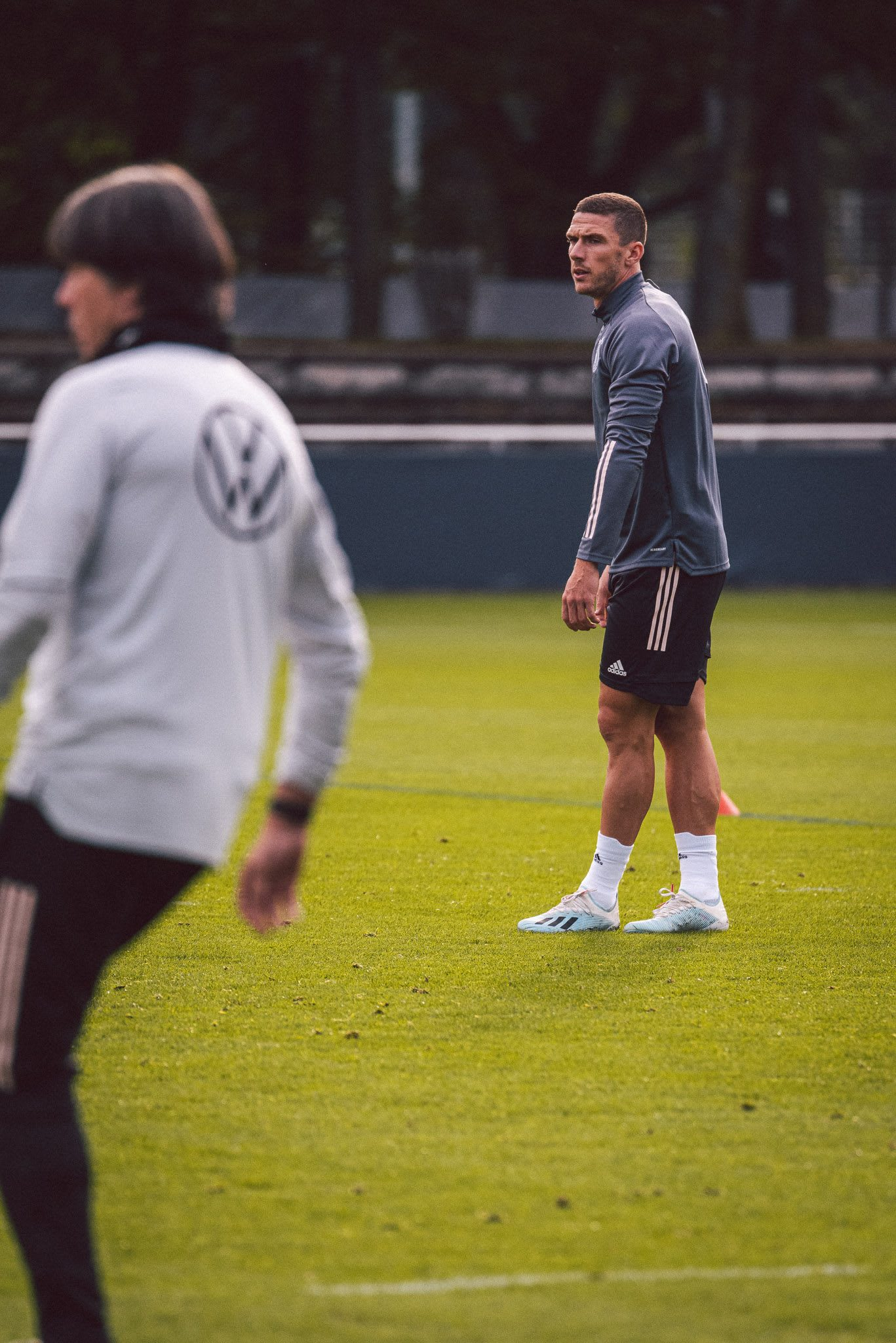 Men on a football field training together, Robin Gosens, footballer, football, German, Germany, team, adidas, sports, exercise, DFB