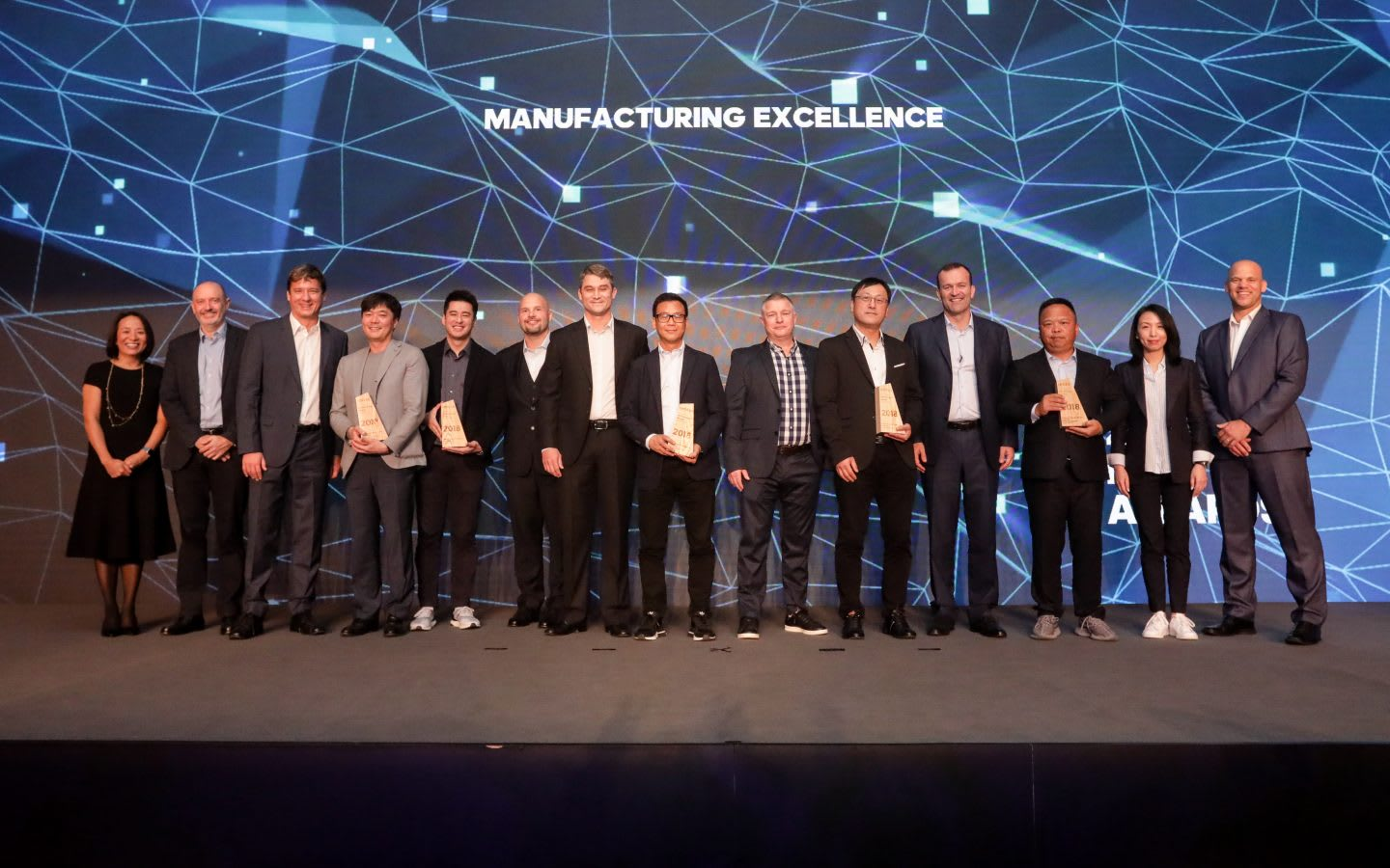People standing on stage in formal attire in a row, leadership, conference, formal, meeting, Hoa Ly, adidas, employee, team