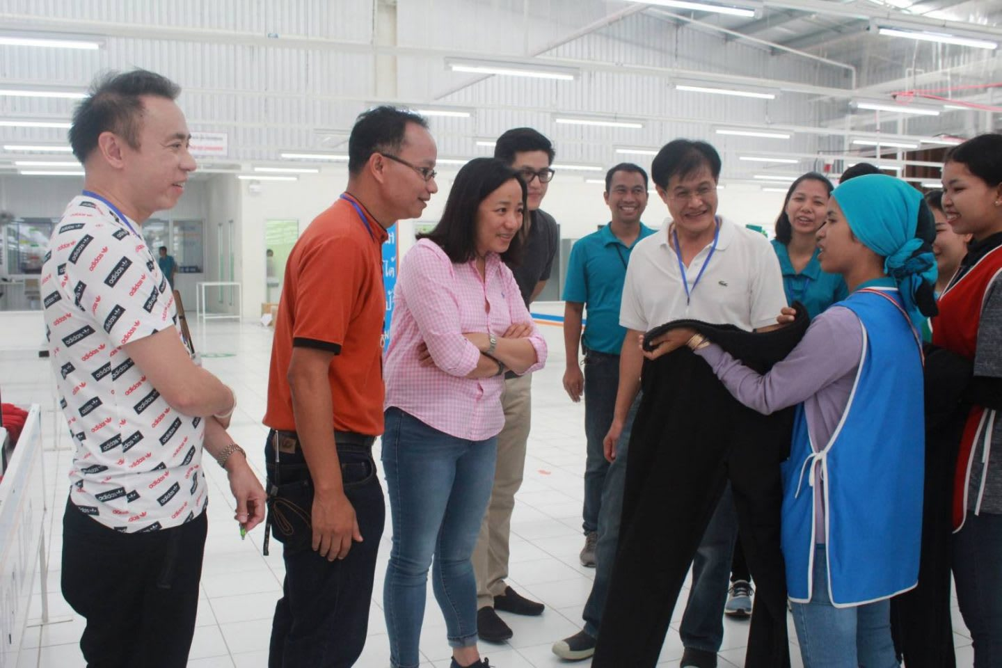 Group of people looking at a fabric from a worker in a factory, Hoa Ly, adidas, Sourcing, employee, Asia, Southeast Asia