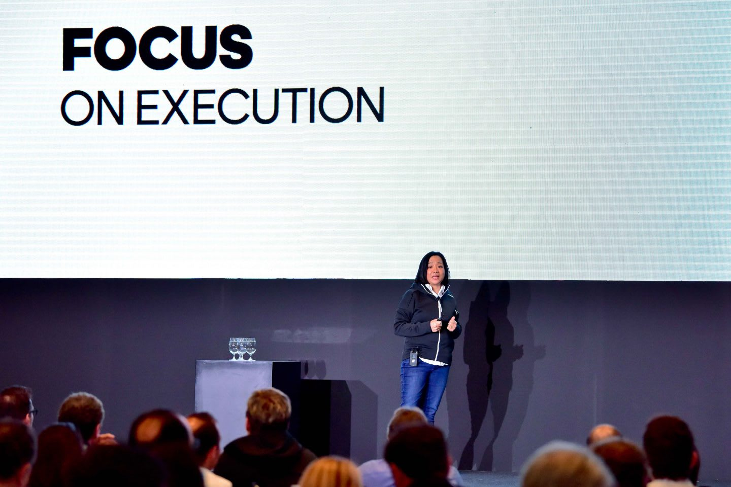 Woman speaking on stage in front of a group of people, public, speaking, Hoa Ly, adidas, woman, leadership, leader, Sourcing, Asia
