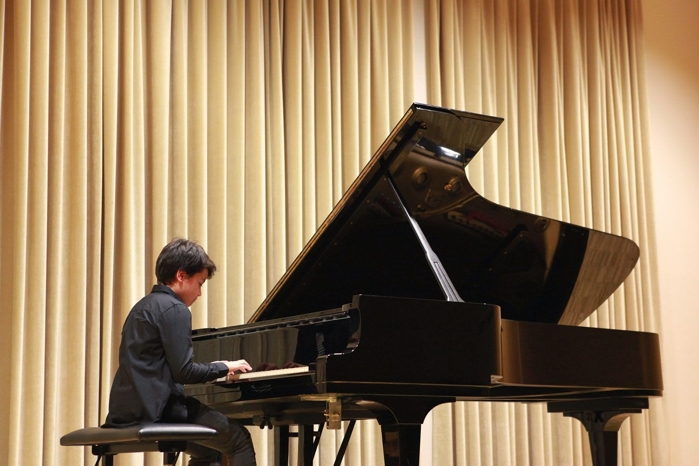 Young boy is playing grand piano at the school concert, child, learning, instrument, recital, music