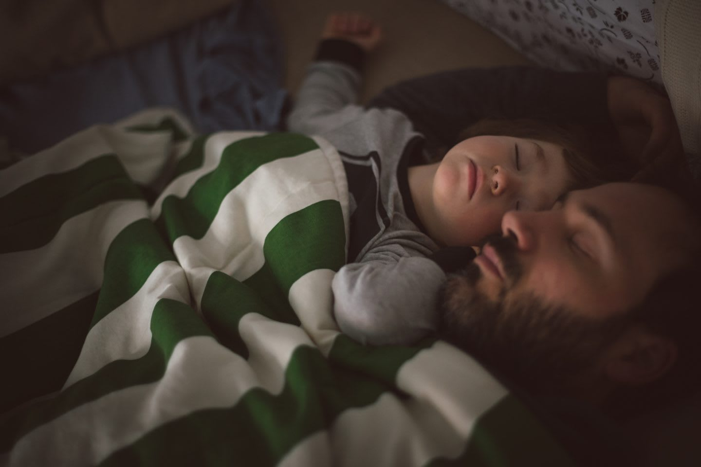 Dad and toddler sleeping together in the sofa, rest, recovery, family, sleep
