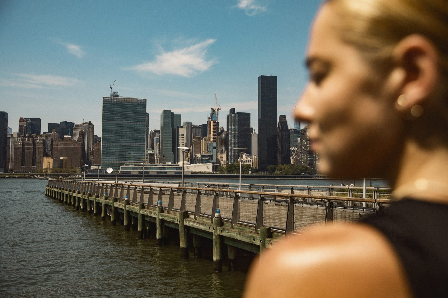 Woman staring out at city skyline, view, city, buildings, metropolitan, adidas, sports, GamePlan A