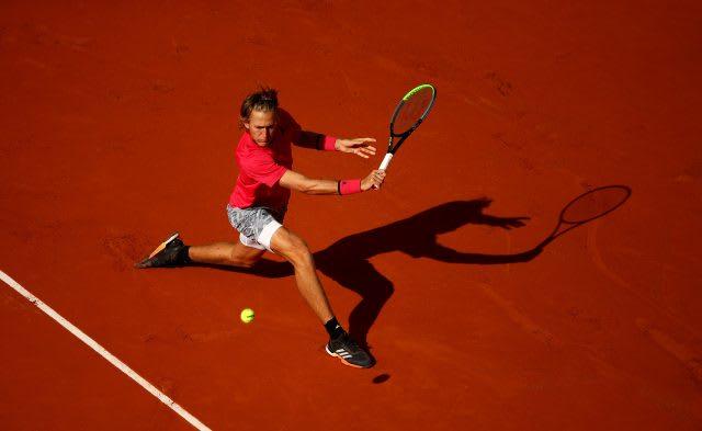 Sebastian Korda playing on clay court. Sebastian Korda, clay court, mindset, adidas, backhand, tennis, Sebastian Korda