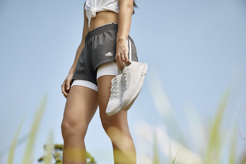 Running model holds Futurecraft.footprint shoes, nature, running, sky, adidas, allbirds, GamePlanA