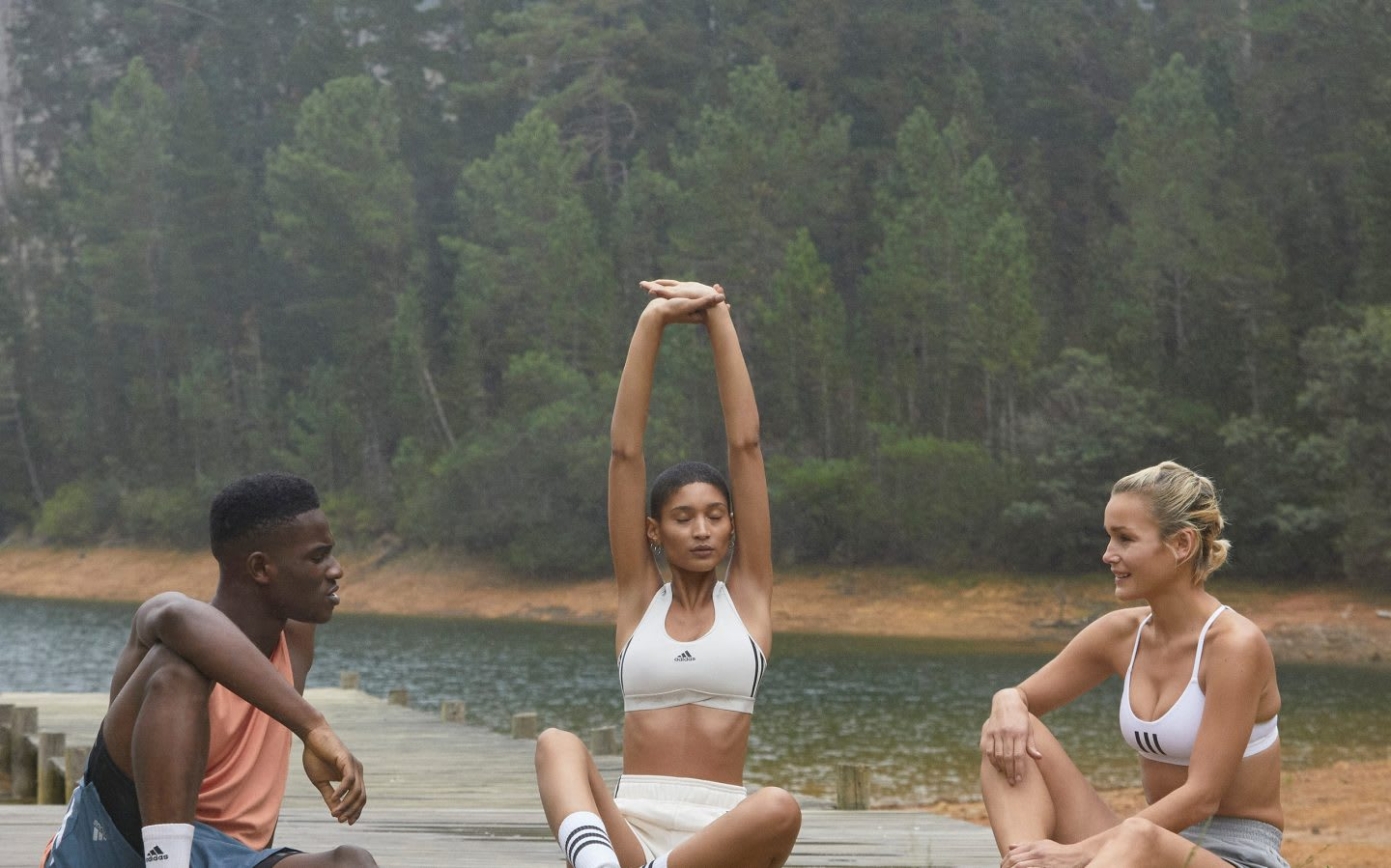 Sport group sitting on a river while talking and stretching, nature, sport, sustainability, adidas, allbirds, GamePlanA