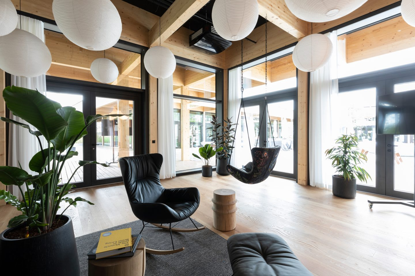 Area to relax with two single chairs and a TV in an open indoor area inside the German national football teams base camp. Home Ground, football, teambuilding, adidas headquarters, GamePlan A.