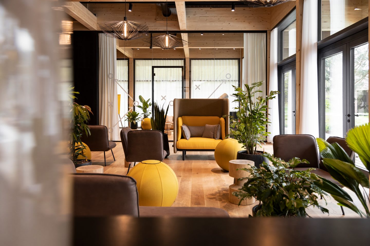 An indoor team area with lounge furniture and focus areas inside the German national football teams base camp. Home Ground, football, teambuilding, adidas headquarters, GamePlan A.