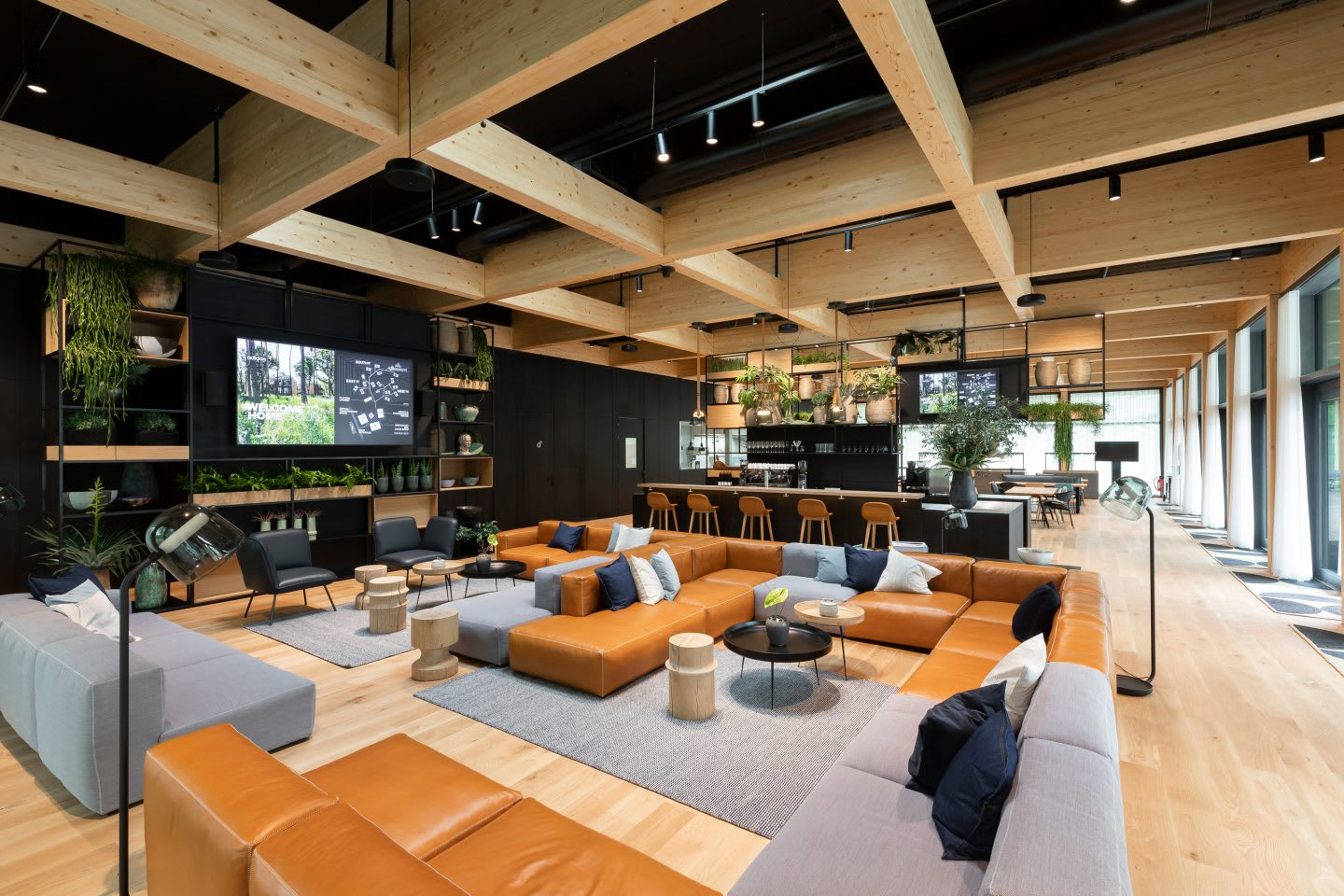 The indoor team area with lounge furniture, a bar and a TV inside the German national football teams base camp. Home Ground, football, teambuilding, adidas headquarters, GamePlan A.