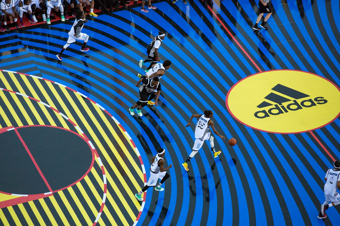 A colourful basketball outdoor court where two teams are competing. Basketball, team sports, team work, success, challenge, GamePlan A.