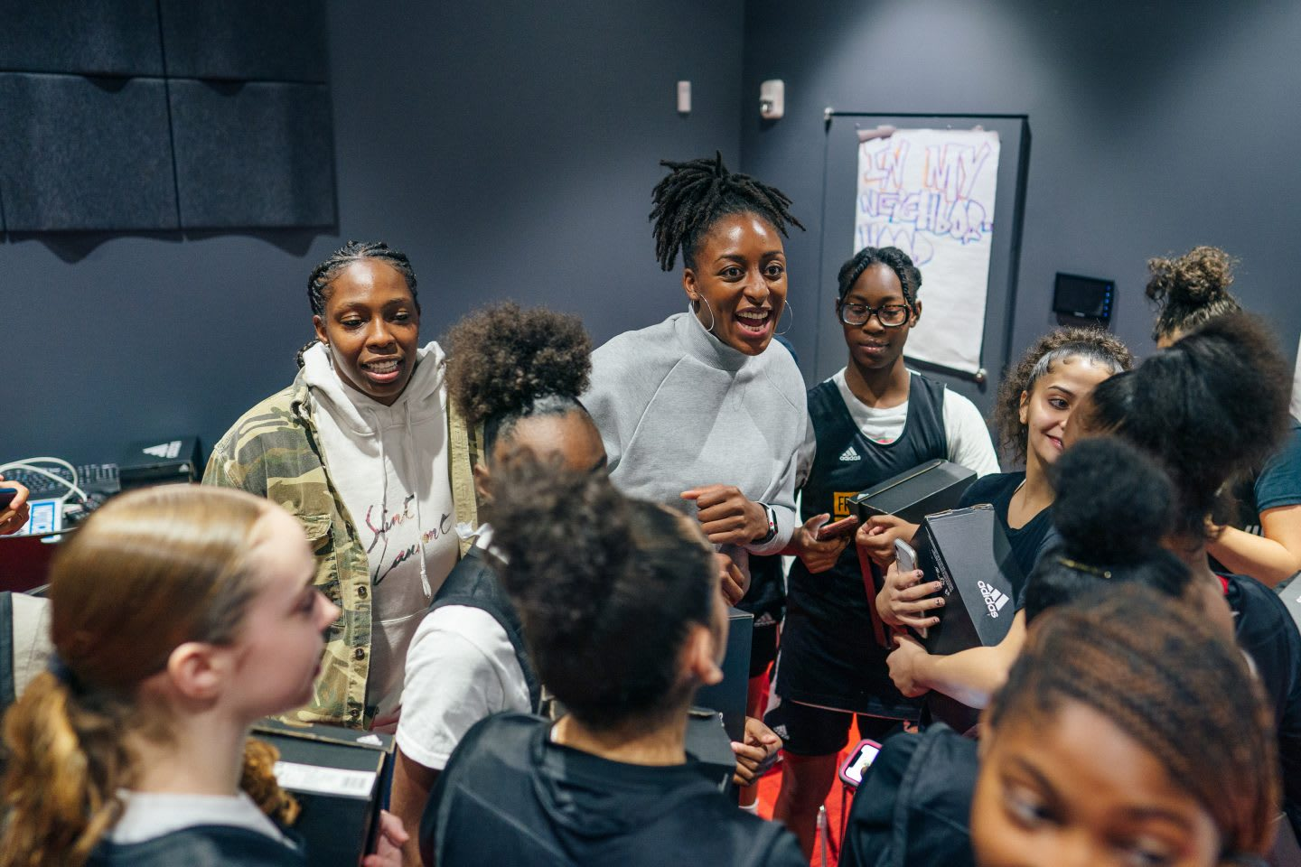 WNBA basketball player Nneka Ogwumike in a group of young players sharing her experiences. Basketball, sports, leadership, role model, icon, GamePlan A.