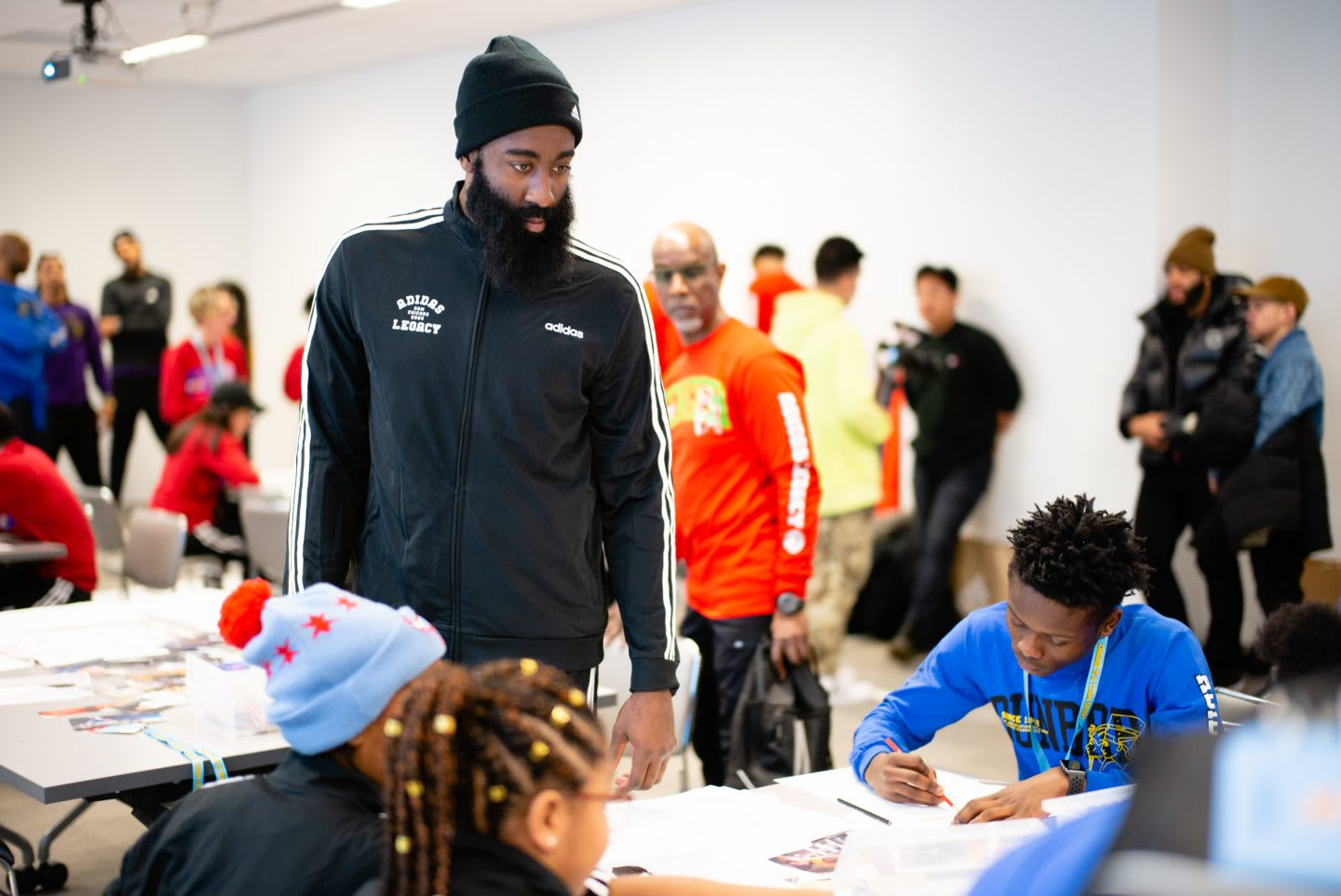 NBA basketball player James Harden at the Career Day getting in touch with children, while they are working on projects. Basketball, sports, leadership, role model, icon, career, development, GamePlan A.