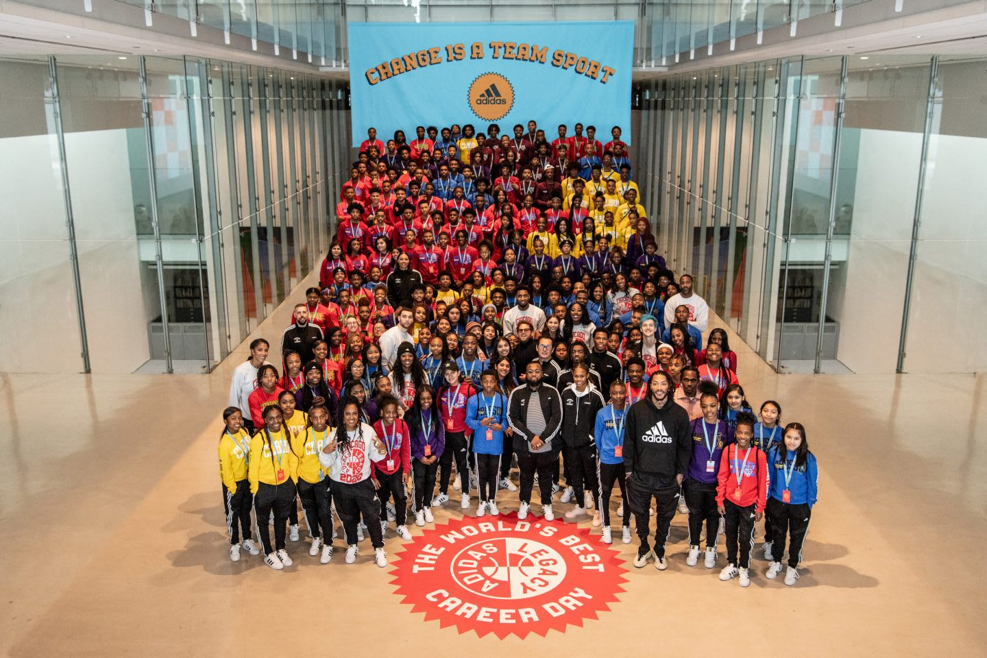 A huge group of young people standing together at the adidas career day. career, team work, team sport, adidas, success, leadership, journey, GamePlan A.