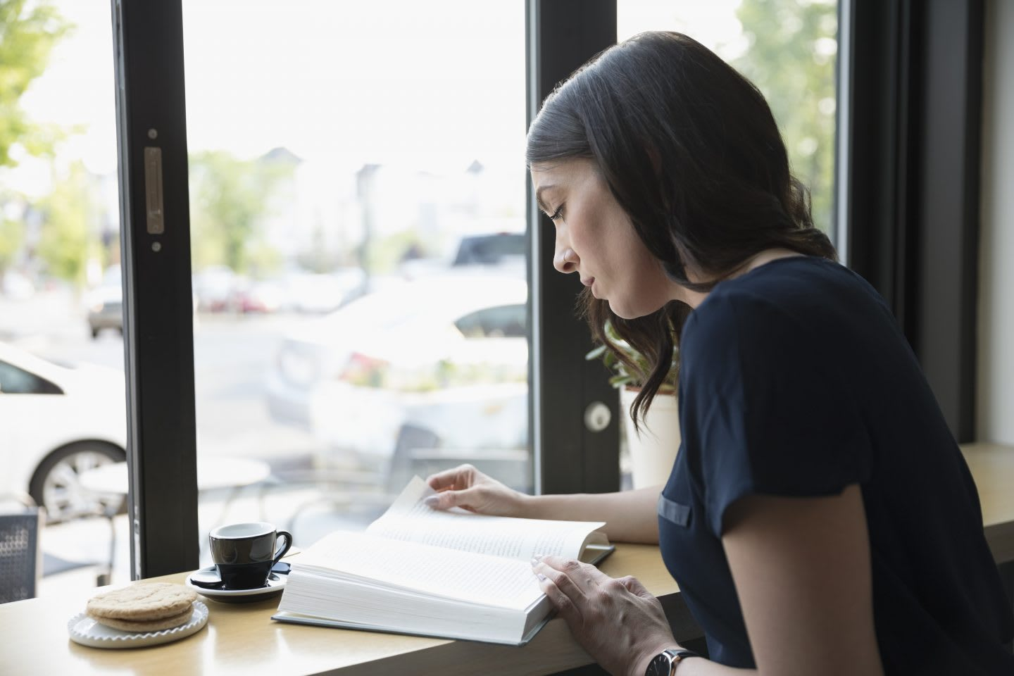 woman reading a book in a cafe. Reading, book, mindset, reading list,
