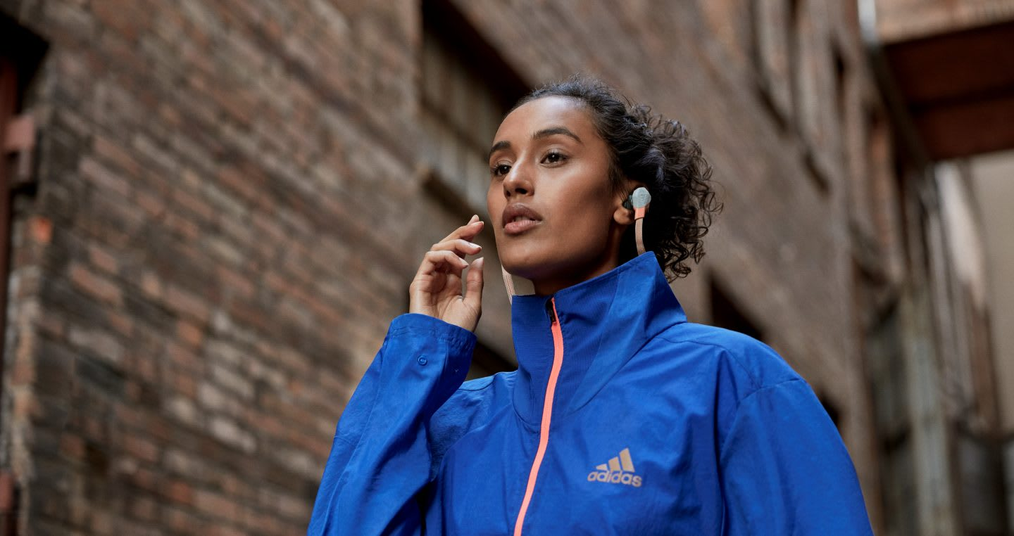 woman listening to a podcast while doing sports. Podcast, listening, learn, race, inclusion