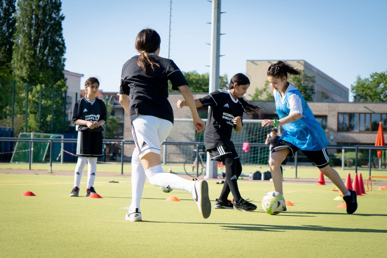 Girls playing football. Community, girls, sport, football, playing football