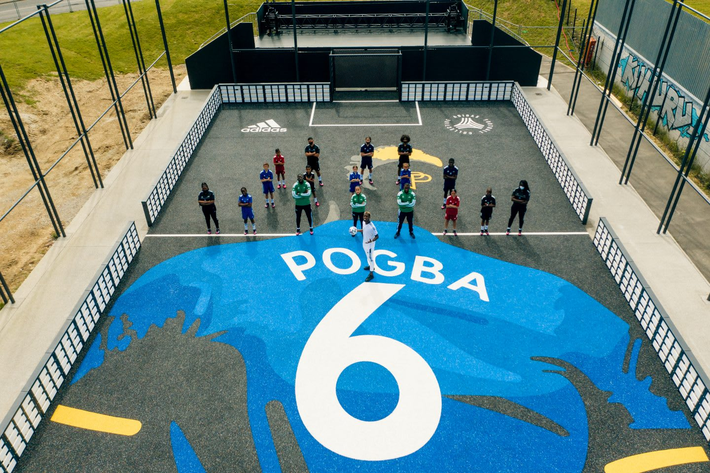 Pogba standing with a group of people on his court. football, community, france, football court, playing football