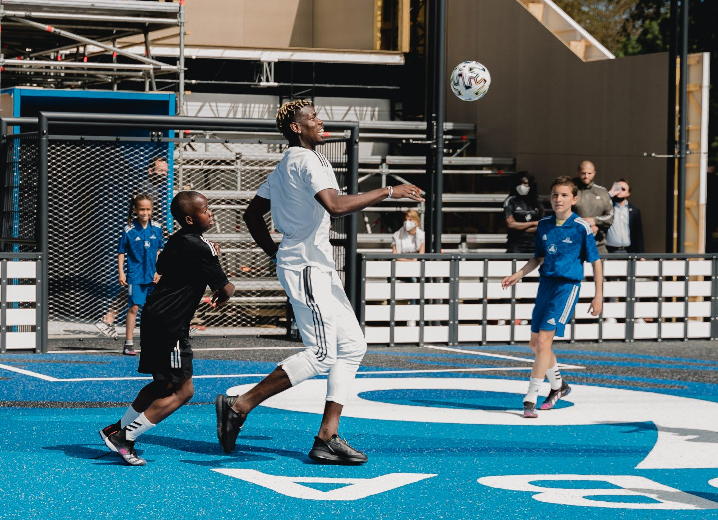 Pogba playing football with kids on his court. Football, france, kids, community, playing football