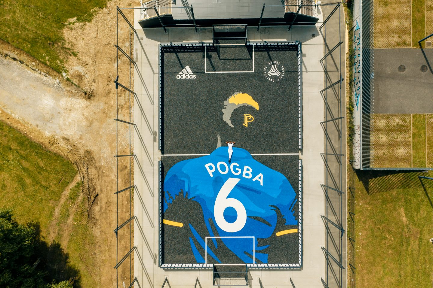 Paul Pogba laying on his own football court. France, star, football, community, possibilities, playing football