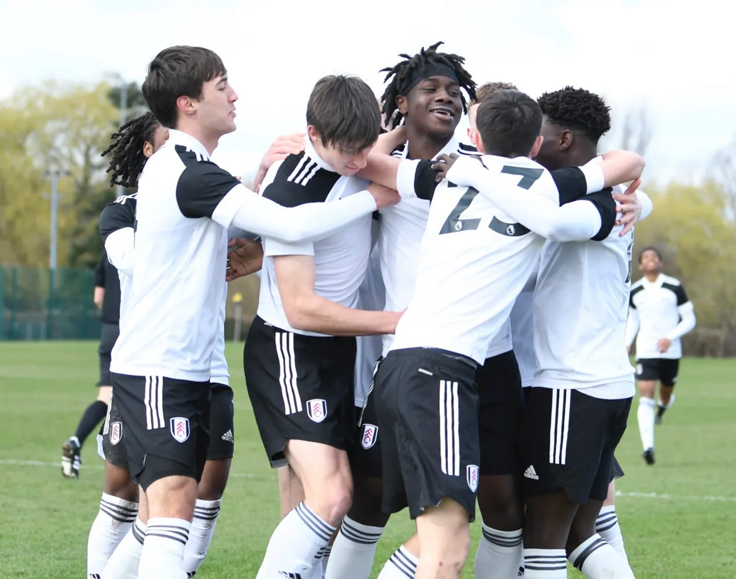Football team celebrates together. Football, together, inclusion, Fulham FC, giving opportunities