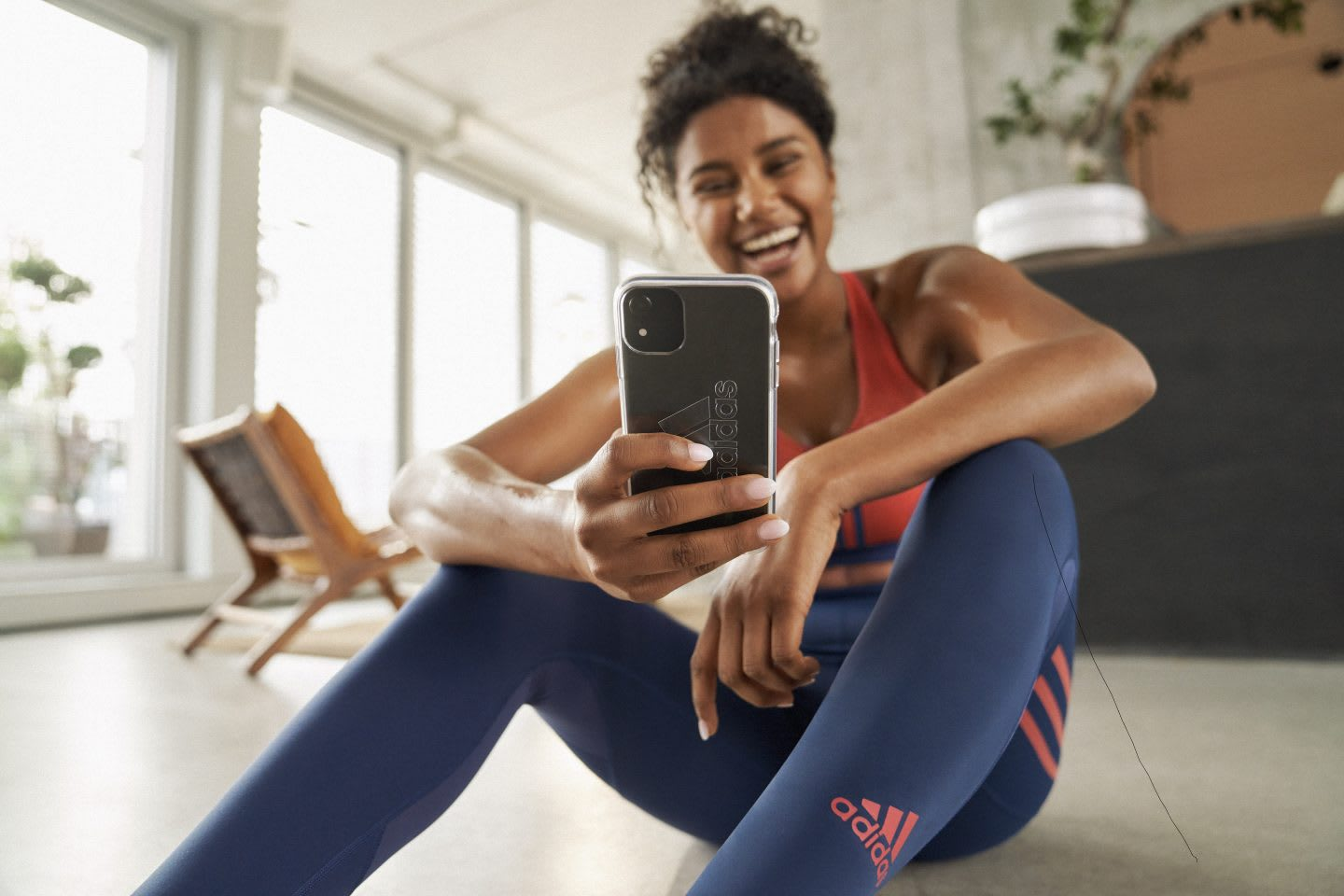 Woman relaxing after workout with the phone. Remote resume, adidas, training, workout, skills