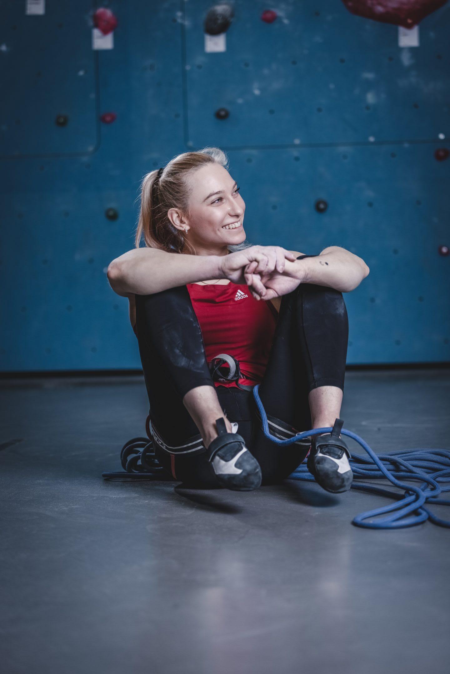 Janja Garnbret sitting and smiling after climbing session. Janja Garnbret, climbing, mindset,