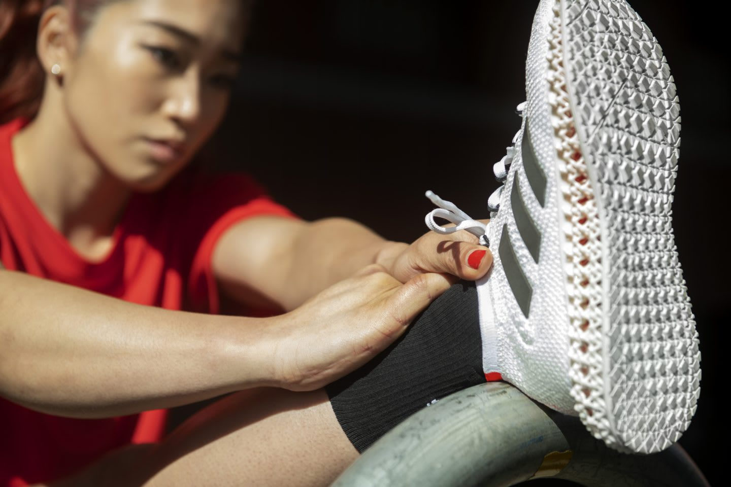 Asian woman stretching out leg before sports session, adidas, Olympics, athlete, sports, sport