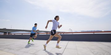 Two people running on concrete, sports, sport, running, Olympics, adidas