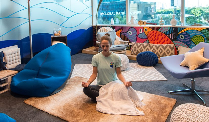 Woman sitting on a floor meditating, employee, adidas, Panama, workspace, worklife, oiffuce