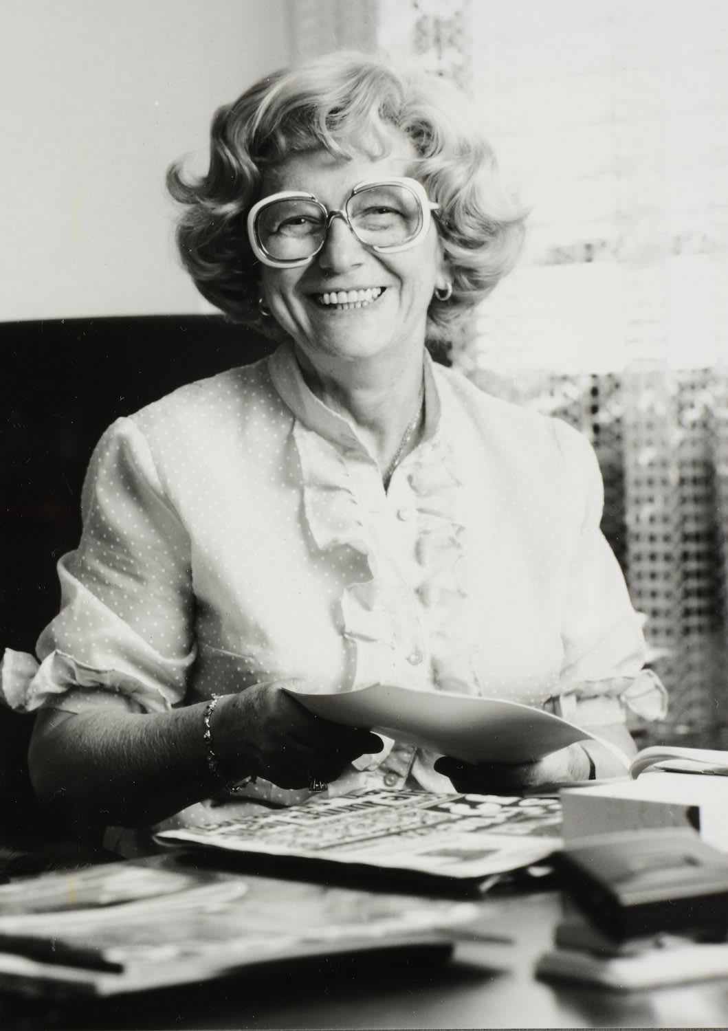 Black-and-white picture of woman in glasses smiling at the camera, Kathe, Dassler, adidas, sports, history