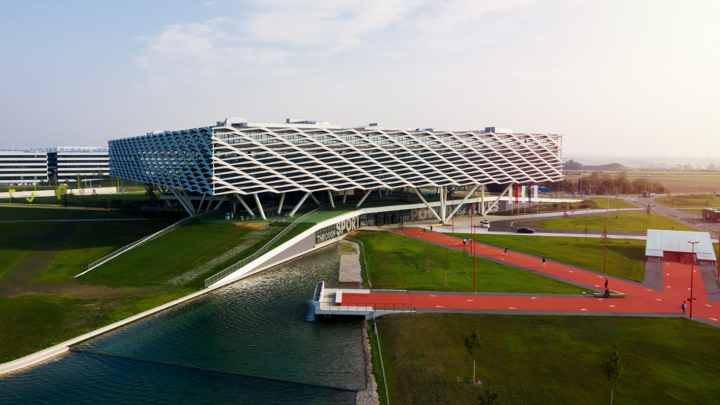 Image of big building with red path leading towards it, Arena, adidas, HQ, headquarters, Herzogenaurach, Germany