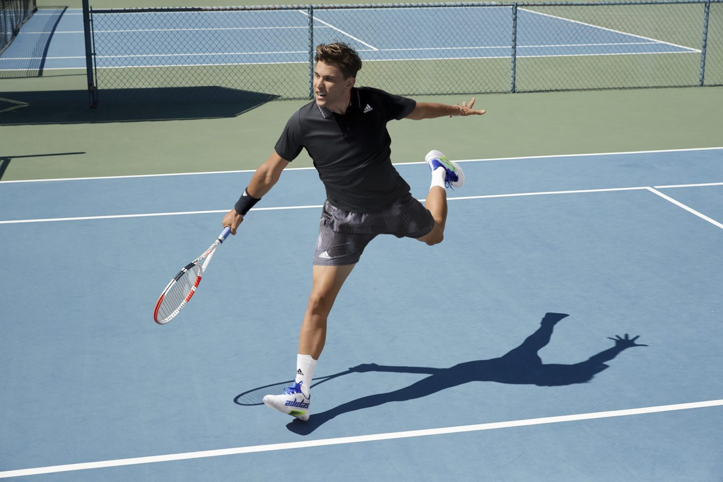 Man wearing black and grey sports clothes holding a tennis racket on a tennis court, Dominic, Thiem, athlete, sports, sport, adidas, tennis, player, GamePlan A