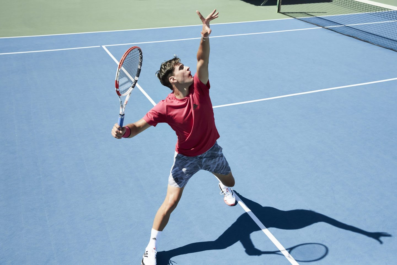 Man wearing red shirt serving a tennis ball on the tennis court, Dominic, Thiem, tennis, player, athlete, sports, sport, adidas, GamePlan A