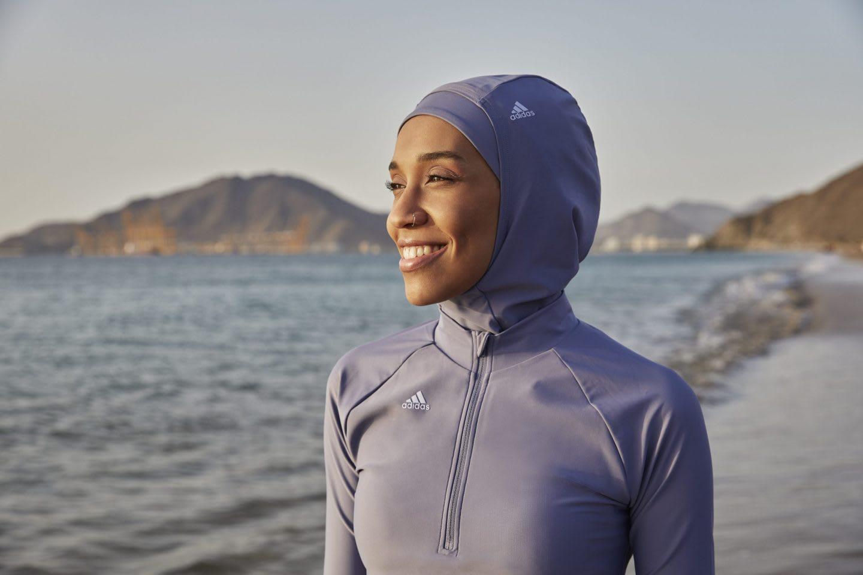 Women wearing a purple sports hijab smiling at the seaside, Asma, Elbadawi, adidas, ambassador, athlete, poet, training, women, sports, sport, swim