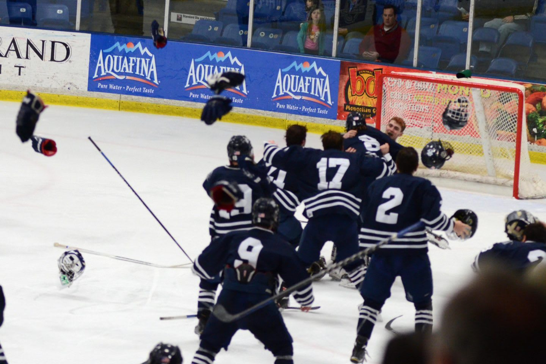 Cranbrook State ice hockey team celebrating together on the ice rink, team, teamwork, team player, sport, sports, ice, hockey