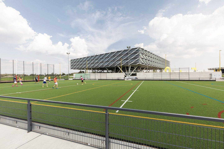Large building behind green astroturf football field, adidas, HQ, headquarters, Herzogenaurach, Germany, sports, company