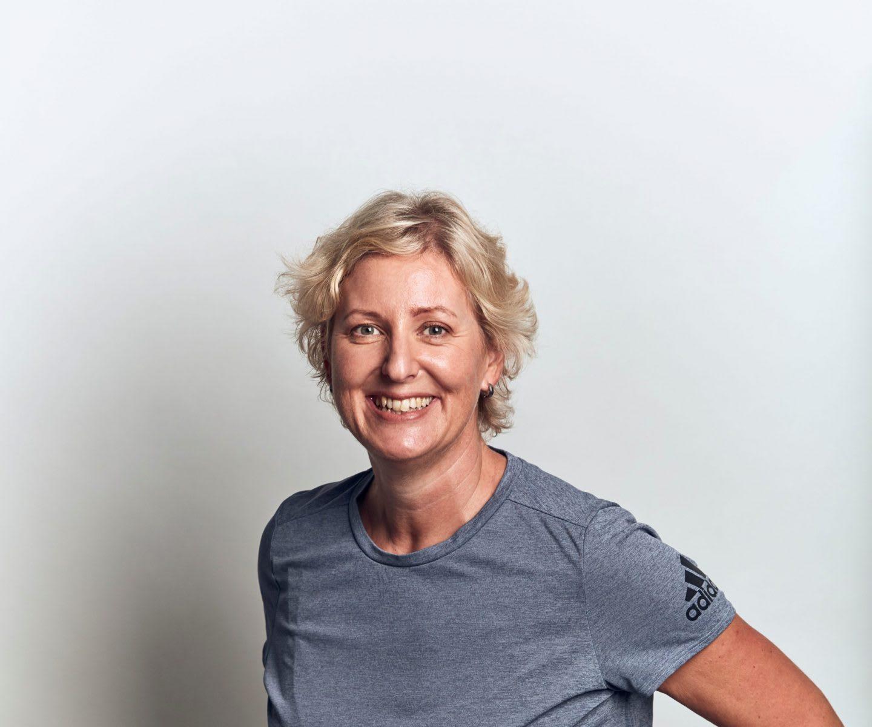 Blonde woman wearing grey t-shirt smiling, Katja, Schreiber, adidas, employee, woman, leader, sustainability