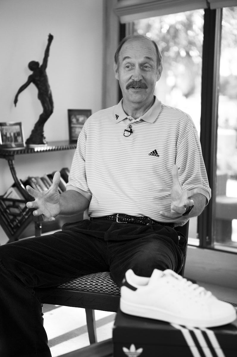 Black and white picture of man wearing adidas polo shirt gesturing while speaking, Stan Smith, tennis, player, athlete, sports, sport